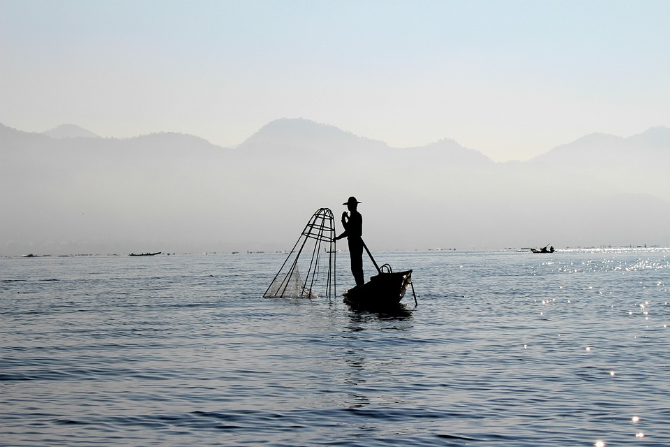 Fisherman with mountains in background